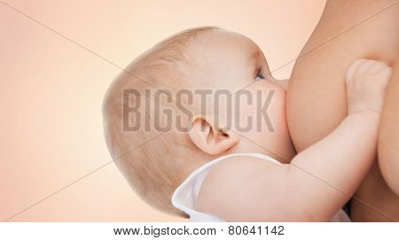 motherhood, children, people and care concept - close up of mother breast feeding adorable baby over beige background poster