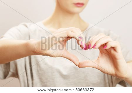 Female hands in the form of heart