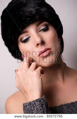 Thoughtful Pretty Woman Wearing Furry Bonnet
