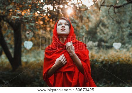 Girl In A Red Dress Standing Look Up In The Garden With Hearts