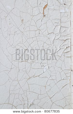 Old white  wooden board with cracked paint texture
