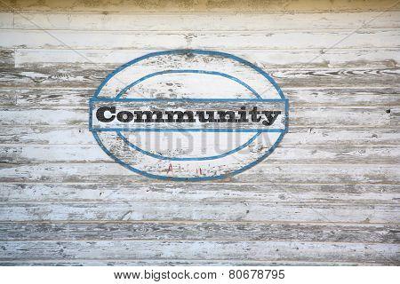 Community sign on shed side
