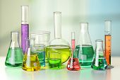 Laboratory glassware on white table and window in background - With Clipping Path on glassware poster