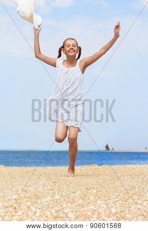 Cheerful Girl Runs Along The Beach