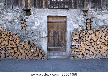 Rustic Barn With Stacks Of Firewood