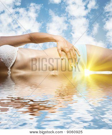 Sexy female body in water