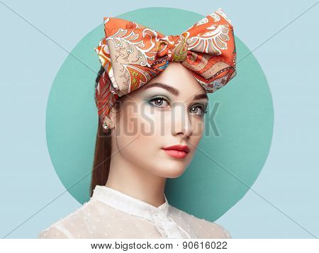 Portrait Of Beautiful Young Woman With Bow