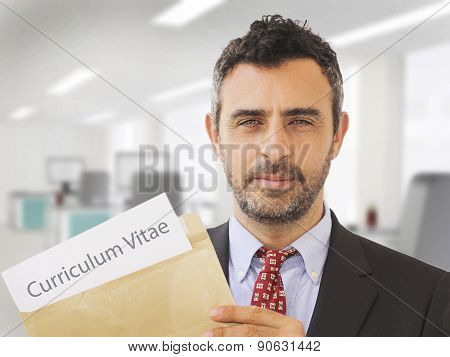 Man inside an office holding CV papers