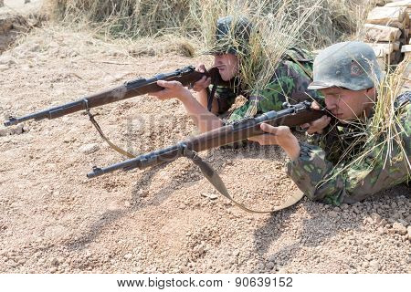 NELIDOVO, RUSSIA- JULY 12, 2014: Battlefield 2014: two Nazi soldiers with rifles in trench