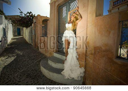 The beautiful bride in a wedding dress on Santorini in Greece.