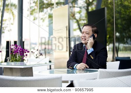 Asian businessman talking on smart phone