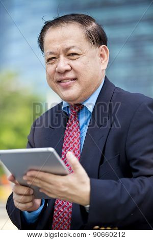 Asian businessman using tablet PC