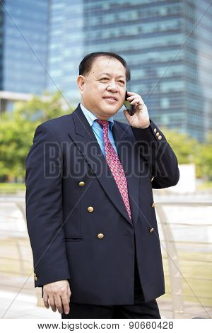 Asian businessman reading newspaper