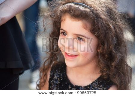 Portrait Of Pretty Girl With Curls