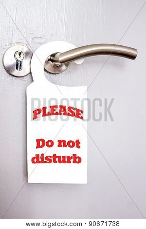 "white signal of ""do not disturb"" on a door poster"