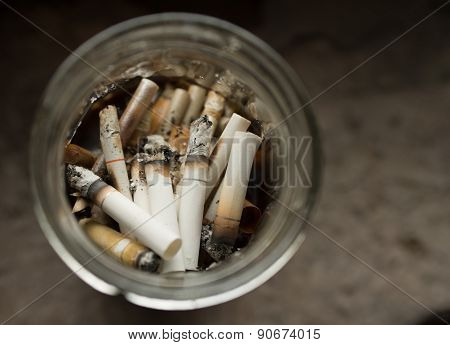 Cigarette Ash And Butts.