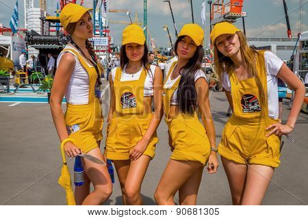 MOSCOW, RUSSIA - JUN 06, 2014: Four girls posing promoter on International Specialized Exhibition of Construction Equipment and Technologies