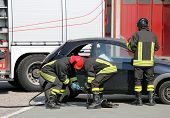practice of firefighters in the Firehouse and simulation of traffic accident poster