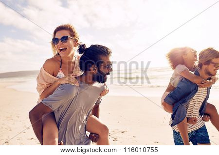 Young People Having Fun On The Beach