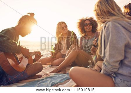 Group Of Friends Partying On The Beach At Sunset