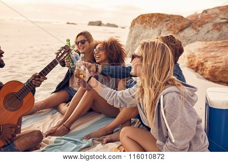 Multi-ethnic Friends Enjoying Beverages On The Beach
