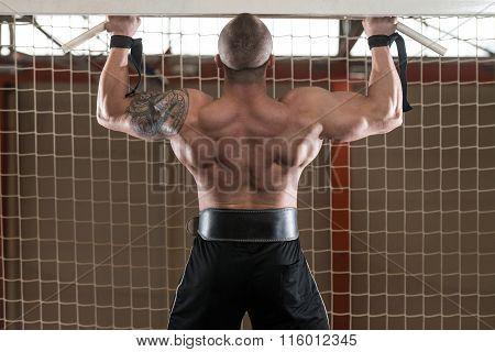 Bodybuilder Doing Pull Ups Best Back Exercises