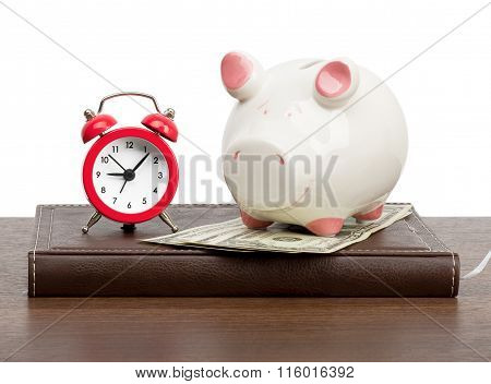 Alarm clock with piggy bank