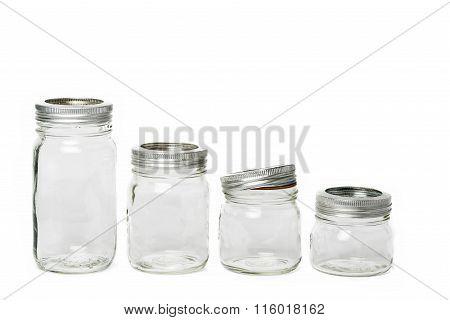 Four Empty Glass Jar