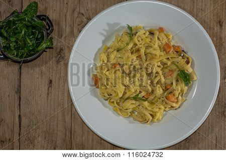 Sweet potato, goat's cheese and red onion tagliatelle plate from above