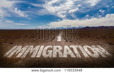 Immigration written on desert road