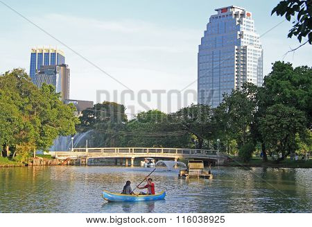 peope are resting in park of Bangkok, Thailand