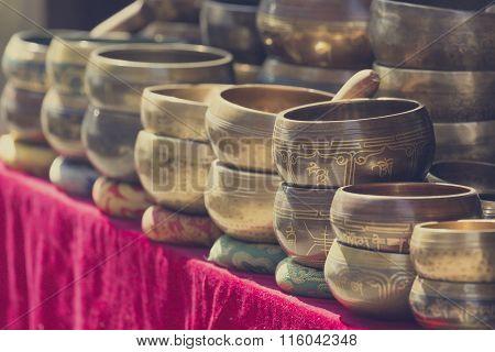 Several Singing Bowls Displayed At A Market In Kathmandu, Nepal