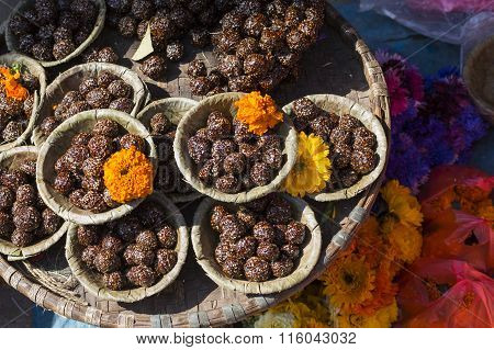 Bowls With Saffron Water And Flowers At Bodhnath Stupa In Kathmandu Valley, Nepal