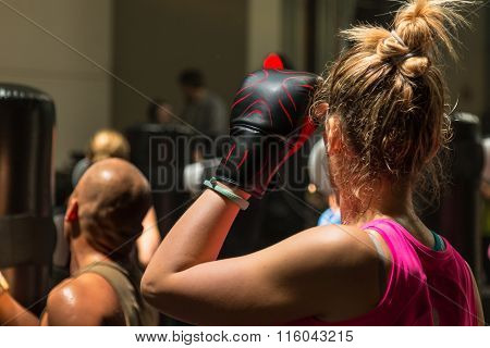 Young Woman With Boxing Glove In Fitness Class