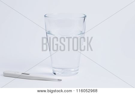 Water Glas And Thermometer