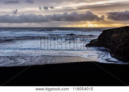 Sunrise by Black sand beach