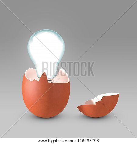 Conceptual picture of nascent idea. Light bulb emerging from eggshell