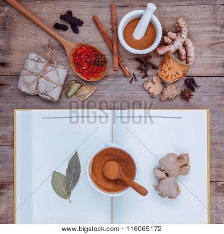 Alternative Health Care Dried Various Chinese Herbs In  Wooden Spoon  With Mortar On Old Wooden Back