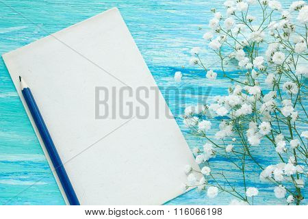 Love Letter and flowers. Couple affection romance. Blue wood background. Top view. Intriguing Secret Story