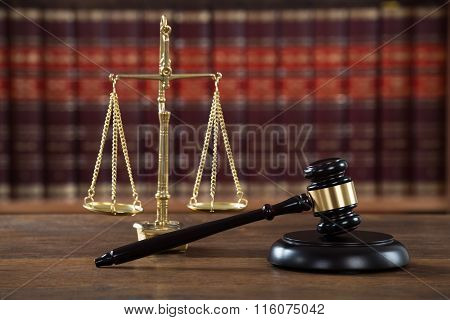 Mallet And Justice Scale On Table In Courtroom