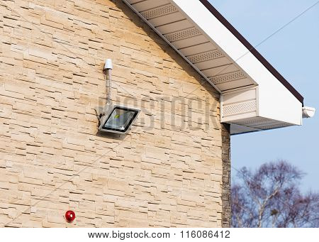 Led Floodlight On Wall Of House.