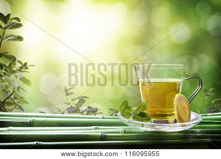 Oriental Green Tea With Mint And Lemon On Bamboo Front