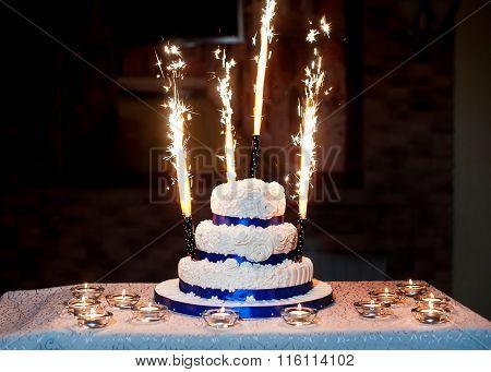Beautiful Three-layered Wedding Cake With Fireworks