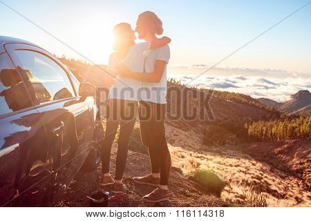 Couple embracing near the car