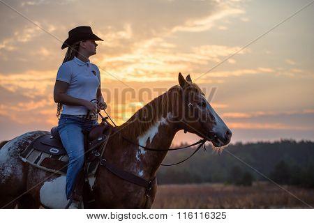 Girl Sit On The Appaloosa Horse