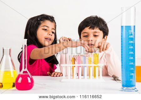 4 year old indian boy and girl doing science experiment, science Education. asian kids and science e