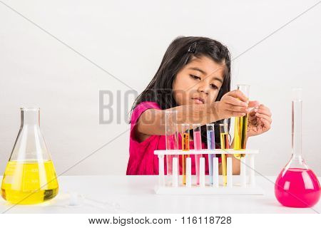 4 year old indian girl doing science experiment