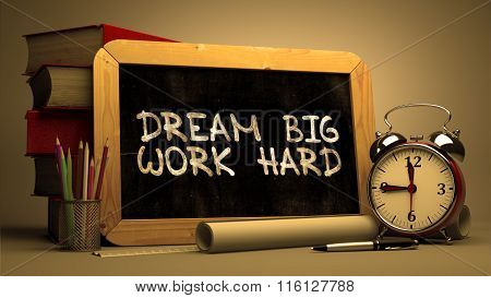 Dream Big Work Hard Handwritten on Chalkboard.