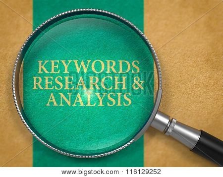 Keywords Research and Analysis through Loupe on Old Paper.