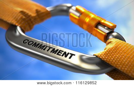 Commitment on Chrome Carabine with a Orange Ropes. Selective Focus. poster